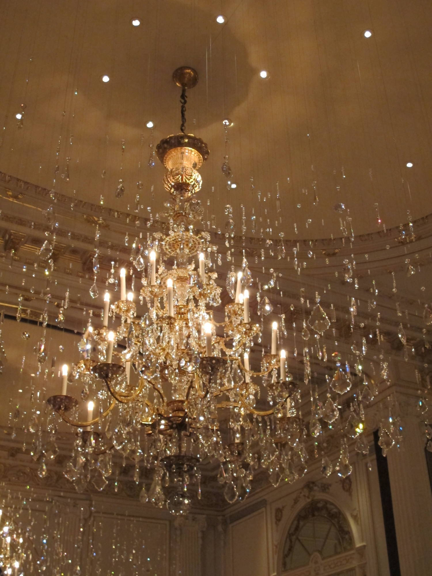 A photograph of a crystal chandelier